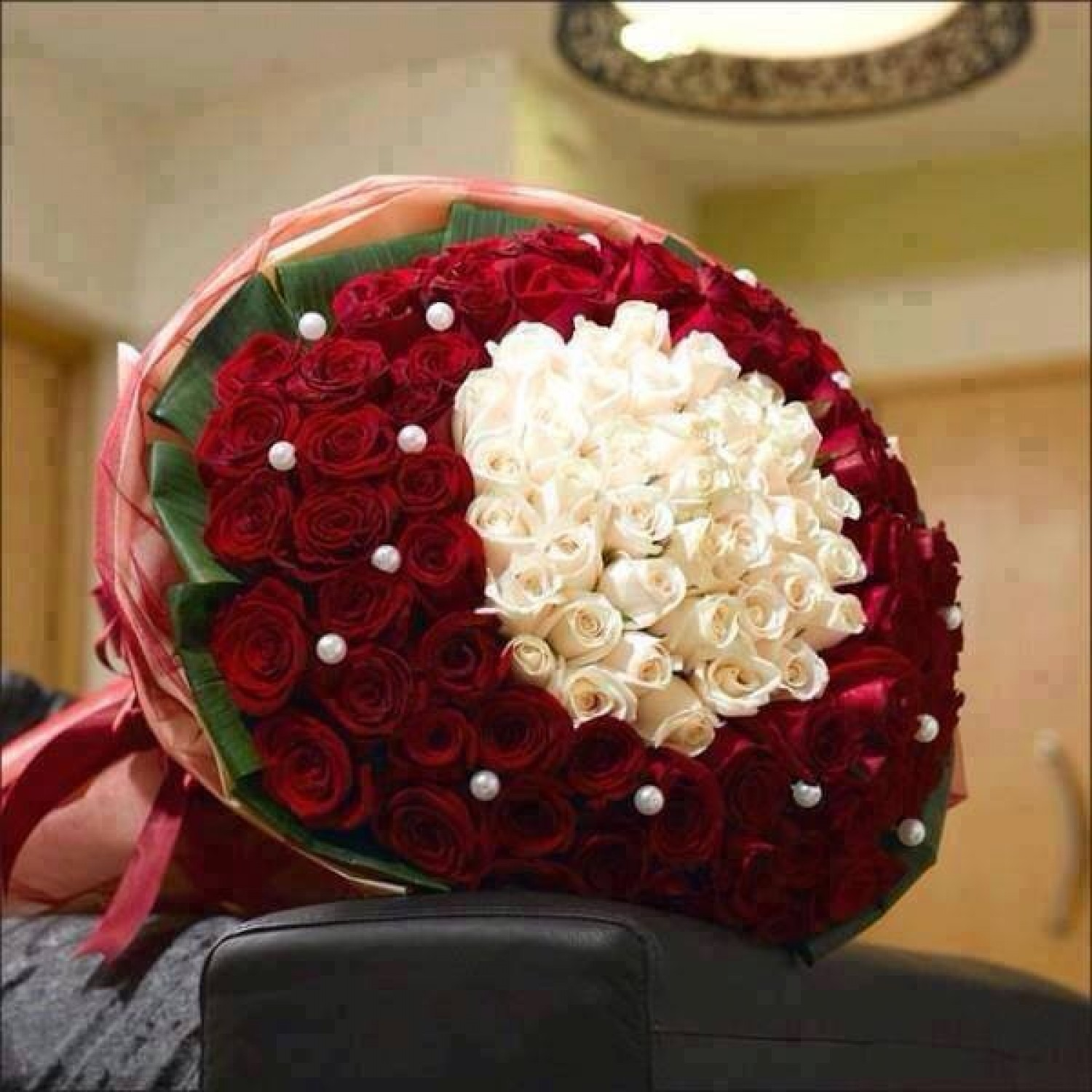 Round Bunch Of 100 Pcs Red Roses N 30 Pcs White Roses In Center