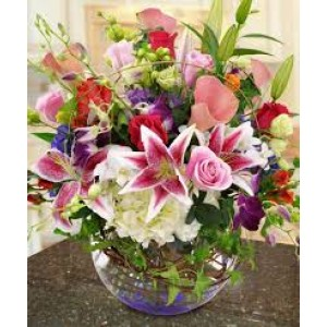 mix flower arrangement in glass vase