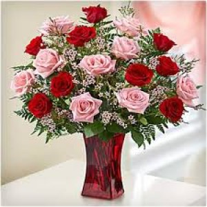10 pink or 10 red roses with fillers in glass vase